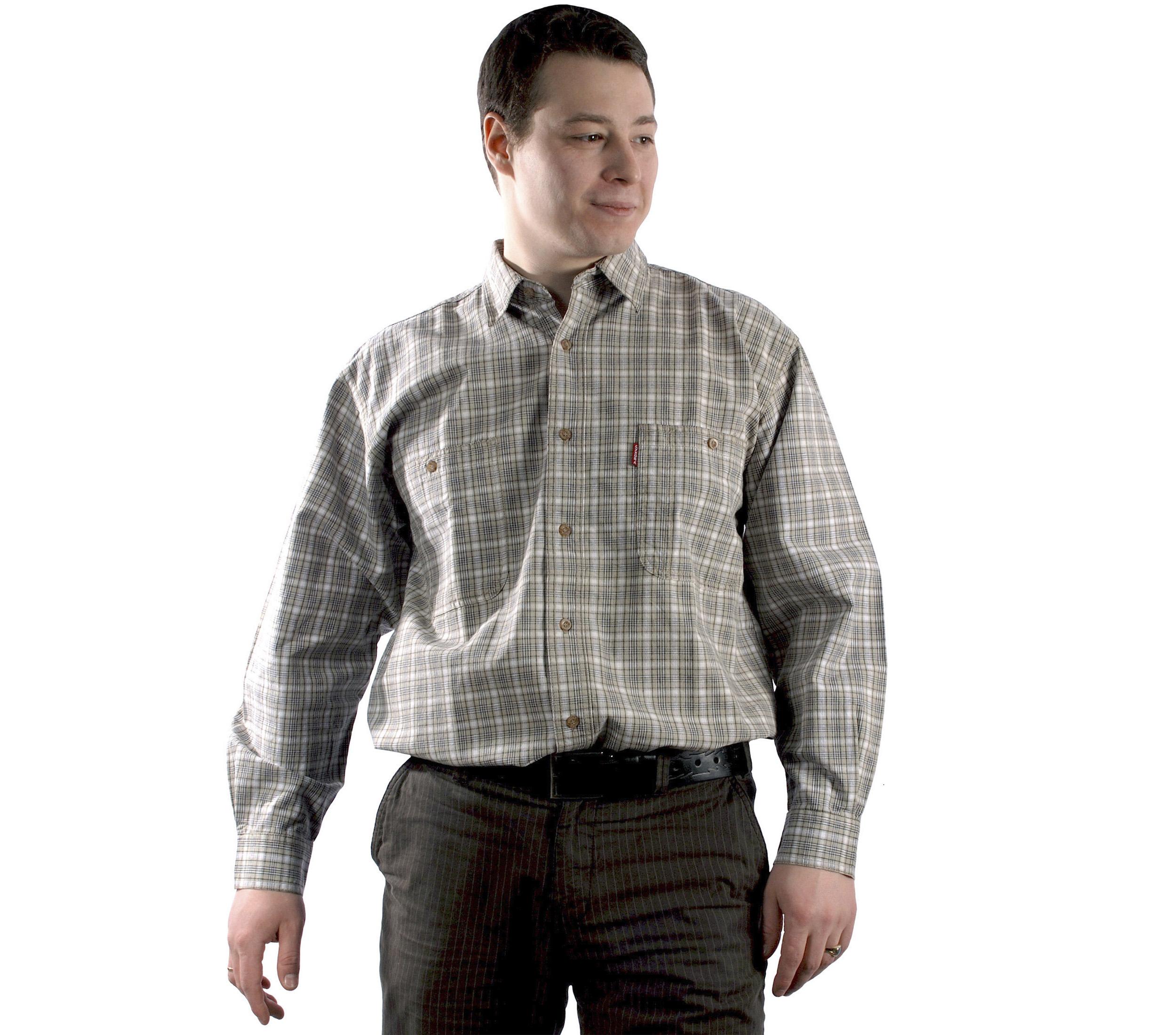Рубашка большого размера в мелкую серого цвета клетку. Средней плотности. Модель длинный рукав с двумя большими карманами свободного кроя.