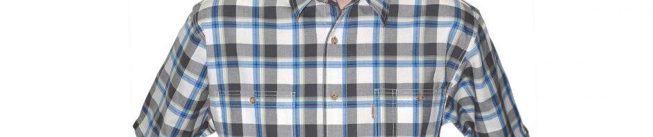 Мужская рубашка с коротким рукавом пепельно белого цвета в серую клетку с сине -желтой полосой. Модель свободного кроя. материал хлопок 100%, толщина материи 32.