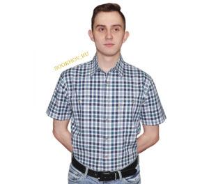Мужская рубашка в среднего размера клетку зеленого и темно-синего цвета. Модель свободного кроя с двумя большими карманами. Толщина материи 32.